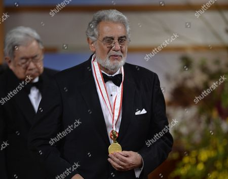 Spanish Tenor Placido Domingo After Receiving a Medal From Japanese Prince Hitachi (l) During the Awards Ceremony of the 25th Praemium Imperiale in Tokyo Japan 16 October 2013 the Praemium Imperiale is a Global Arts Prize Awarded Annually by the Japan Art Association Five Laureates Are Nominated in the Fields of Painting Sculpture Architecture Music and Theatre/film For Its 25th Edition the Praemium Imperiale Awards Have Been Given to Italian Painter Michelangelo Pistoletto British Sculptor Antony Gormley British Architect David Chipperfield Us Film Director Francis Ford Coppola and Spanish Tenor Placido Domingo Japan Tokyo