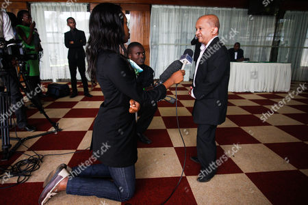 Kenyan-born Hollywood Actor Kiran Shah (r) is Being Interviewed by a Local Tv Channel While Attending the Official Launch of the 'Association of People with Dwarfism - Kenya' in Nairobi Kenya 03 December 2013 the Association Wants to Support Short People and Fight Discrimination in the Society Kenya Nairobi