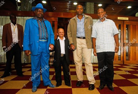 Stock Picture of Kenyan-born Hollywood Actor Kiran Shah (2-l) Poses with Fans While Attending the Official Launch of the 'Association of People with Dwarfism - Kenya' in Nairobi Kenya 03 December 2013 the Association Wants to Support Short People and Fight Discrimination in the Society Kenya Nairobi