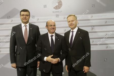 Latvian Minister For Finance Janis Reirs (l) Spanish Economy Minister Luis De Guindos and Governor of Central Bank of Latvia Ilmars Rimsevics During Hand Shakes at Informal Meeting of Ministers For Economic and Financial Affairs (ecofin) in Riga Latvia 25 April 2015 Latvia Riga