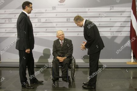 Latvian Minister For Finance Janis Reirs (l) Germany's Federal Minister of Finance Wolfgang Schauble and Governor of Central Bank of Latvia Ilmars Rimsevics During Hand Shakes at Informal Meeting of Ministers For Economic and Financial Affairs (ecofin) in Riga Latvia 25 April 2015 Latvia Riga