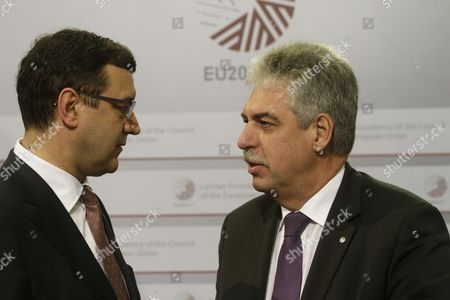 Latvian Minister For Finance Janis Reirs (l) and Austria's Federal Minister For Finance Johann Schelling During Hand Shakes at Informal Meeting of Ministers For Economic and Financial Affairs (ecofin) in Riga Latvia 25 April 2015 Latvia Riga