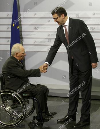Latvian Minister For Finance Janis Reirs (r) Greets Germany's Federal Minister of Finance Wolfgang Schauble Atthe Informal Meeting of Ministers For Economic and Financial Affairs (ecofin) in Riga Latvia 25 April 2015 Latvia Riga