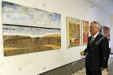 Italian Ambassador to Lebanon Giuseppe Morabito Looks at a Painting by Italian Artist Marco Ceravolo During His Exhibition Organized by the Italian Embassy in Beirut Lebanon 11 September 2013 the Exhibit Runs From 11 September to 05 October Lebanon Beirut