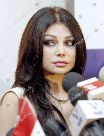Lebanese Pop Star Haifa Wehbe Attends During a Press Conference After She was Appointed As Communications Ambassador For Humanitarian Issues For Lebanon at Crown Plaza Hotel in Beirut Lebanon 18 October 2013 Under the New Post Haifa Will Work on Increasing Awareness of Dangers of Using Communication Technology While Driving Lebanon Beirut