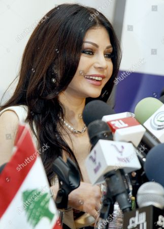 Stock Picture of Lebanese Pop Star Haifa Wehbe Speaks During a Press Conference After She was Appointed As Communications Ambassador For Humanitarian Issues For Lebanon at Crown Plaza Hotel in Beirut Lebanon 18 October 2013 Under the New Post Haifa Will Work on Increasing Awareness of Dangers of Using Communication Technology While Driving Lebanon Beirut