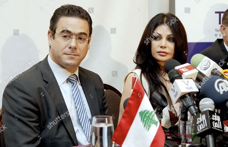 Lebanese Pop Star Haifa Wehbe (r) Attends a Joint Press Conference with Lebanese Telecommunications Minister Nicolas Sahnawi (l) After She was Appointed As Communications Ambassador For Humanitarian Issues For Lebanon at Crown Plaza Hotel in Beirut Lebanon 18 October 2013 Under the New Post Haifa Will Work on Increasing Awareness of Dangers of Using Communication Technology While Driving Lebanon Beirut