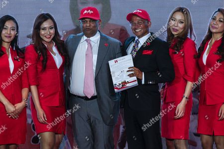 Airasia Group Ceo Tony Fernandes (3-l) and Airasia X Ceo Azran Osman-rani (3-r) Posed with Airasia Flight Attendants During the Launch of Airasia X Prospectus For Initial Public Offering (ipo) in Kuala Lumpur Malaysia 10 June 2013 Airasia X Low Cost Long-haul Air Carrier Launches Its Prospectus For Ipo on 10 June Malaysia Kuala Lumpur