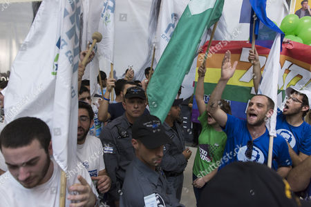 Stock Photo of Israeli Border Police Come Between Supporters of the Left-of-center Zionist Union Party (r) As They Scream Slogans Against Naftali Bennet of the Bait Yehudit Party Calling Him Homophobic As His Supporters Face Off at Left During a Clash of Words in Campaigning in a Shopping Mall in Rehovot Israel 10 March 2015 One Week Before the General Elections on March 17 Israel Rehovot