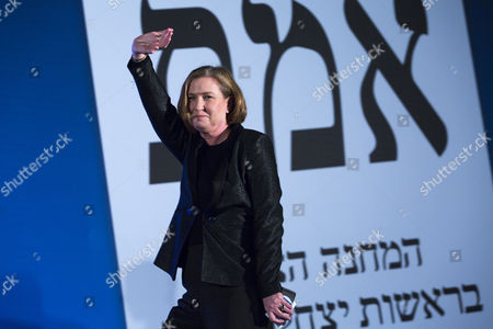 Tzipi Livni the Number Two on the Zionist Union Party Comes on Stage Waving As She Passes the Zionist Union Party Voting Ticket As She and Isaac Herzog the Party's Leader Address the Nation Supporters and Activists From the Party's Election Results Headquarters in Tel Aviv Israel Late 17 March 2015 After the Television Predictions Giving the First Results of the Israeli General Election Israel Tel Aviv