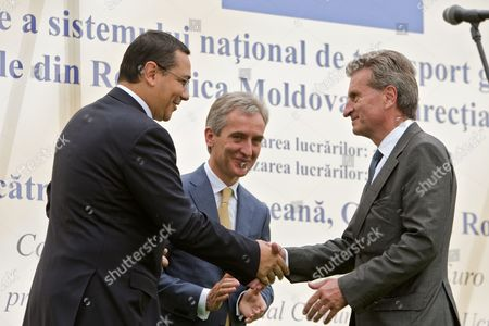 Prime Minister of Romania Victor Ponta (l) with His Moldovan Counterpart Iurie Leanca (c) Shake Hands with Guenther Oettinger European Commissioner For Energy (r) During the Inauguration of the Iashi-ungheni Moldovan-romanian Gas Pipeline in Zagarancea Village Ungheni District 124 Kms North-west of Chisinau Moldova 27 August 2014 Moldova, Republic of Ungheni