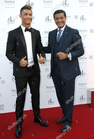 Us Jeweller and Chairman of Jacob & Co Jacob Arabo (r) Arrives with Portuguese Soccer Player and Brand Ambassador of Jacob and Co Cristiano Ronaldo (l) at the Cocktail Gala Held at the Hotel De Paris in Monaco 04 July 2013 an Exhibition of Pieces by Jewelry Company Jacob & Co is Held at the Hotel De Paris to Celebrate the 150 Anniversary of the Sbm (societe Des Bains De Mer) Company of Monaco Monaco Monaco