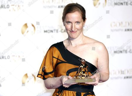 Us Producer Melissa Bernstein Poses with His Golden Nymph Award During the Closing Award Ceremony of the Monte Carlo Television Festival in Monaco 13 June 2013 the Festival Runs From 09 to 13 June Monaco Monte Carlo