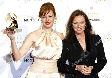 Stock Image of Hungarian Actress Eszter Onodi Holding Her Best Actress Golden Nymph Award Poses with French Actress Jacqueline Bisset During the Closing Award Ceremony of the Monte Carlo Television Festival in Monaco 13 June 2013 the Festival Runs From 09 to 13 June Monaco Monte Carlo