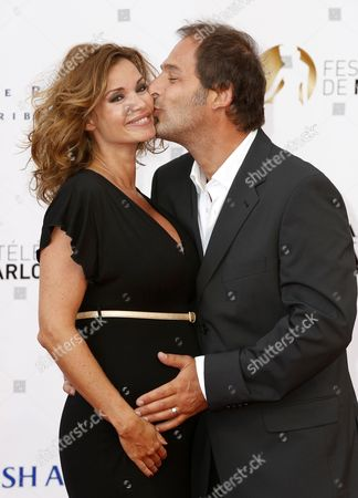 French Actress Ingrid Chauvin (l) and Her Husband Thierry Peythieu (r) Pose For the Media As They Arrive on the Red Carpet For the Opening Ceremony of the Monte Carlo Television Festival in Monte Carlo Monaco 09 June 2013 the Festival Runs From 09 to 13 June Monaco Monte Carlo