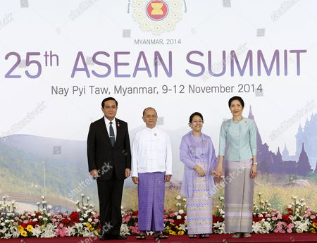 Thailand Prime Minister Prayut Chan-o-cha (l) and Wife Naraporn Chan-o-cha (r) Stand For a Photo As They Are Officially Greeted by Myanmar President Thein Sein (2-l) and His Wife Khin Khin Win (2-r) For the Start of the 25th Association of South East Asian Nations (asean) Summit at the Myanmar International Convention Center in Naypyitaw Myanmar 12 November 2014 South-east Asian Leaders Gathered in Myanmar's Capital Naypyidaw on 12 November For the Bi-annual Asean Summit with the Focus Expected to Be on Economic Ties and Regional Territorial Disputes the Final Provisions of the Asean Economic Community - Due to Be Completed in December 2015 - Will Be High on the Agenda of the Two-day Conference the 10 Member Countries Will Also Be Launching a Green Economy Initiative to Combat Global Warming Asean Comprises Brunei Indonesia Malaysia the Philippines Singapore Thailand Vietnam Cambodia Laos and Myanmar the Asean Meetings Will Also Include Leaders From South Korea Australia New Zealand and Russia Myanmar Naypyitaw