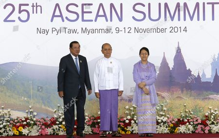 Cambodia Prime Minister Hun Sen (l) Stands For a Photo with Myanmar President Thein Sein (c) and His Wife Khin Khin Win (r) at the Official Greeting at the Start of the 25th Association of South East Asian Nations (asean) Summit at the Myanmar International Convention Center in Naypyitaw Myanmar 12 November 2014 Myanmar Hosts the Summit From 09-13 November Between Asean Member Countries and Its Dialogue Partners Also a Meeting of the East Asia Summit (eas) Forum Aimed to Strengthen Political and Cultural Ties and Discuss Solution and Advancements of a Robust Global Economy Myanmar Naypyitaw