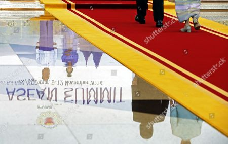 The Legs of Thailand Prime Minister Prayut Chan-o-cha and His Wife Naraporn Chan-o-cha As They Walk on the Red Carpet Towards Myanmar President Thein Sein and His Wife Khin Khin Win Reflected in the Highly Polished Floor of the Grand Hall Waiting to Officially Greet Them For the Opening Ceremony of the 25th Association of South East Asian Nations (asean) Summit at the Myanmar International Convention Cente Rin Naypyitaw Myanmar 12 November 2014 the Thai Prime Minister Came to Power in a Coup D'etat in May This Year and is Now Making His International Debut to World Leaders After Promising to Restore and Maintain Stability in Thailand Myanmar Naypyitaw
