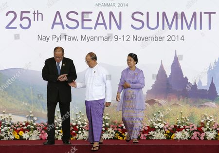 Myanmar President Thein Sein (2-l) with His Wife Khin Khin Win (r) Guides Philippines President Benigno Aquino Iii (l) Into the Opening Ceremony As He is the Last to Arrive at the Official Leaders Greeting at the 25th Association of South East Asian Nations (asean) Summit Opening Ceremony at Myanmar International Convention Center in Naypyitaw Myanmar 12 November 2014 South-east Asian Leaders Gathered in Myanmar's Capital Naypyidaw on 12 November For the Bi-annual Asean Summit with the Focus Expected to Be on Economic Ties and Regional Territorial Disputes the Final Provisions of the Asean Economic Community - Due to Be Completed in December 2015 - Will Be High on the Agenda of the Two-day Conference the 10 Member Countries Will Also Be Launching a Green Economy Initiative to Combat Global Warming Asean Comprises Brunei Indonesia Malaysia the Philippines Singapore Thailand Vietnam Cambodia Laos and Myanmar the Asean Meetings Will Also Include Leaders From South Korea Australia New Zealand and Russia Myanmar Naypyitaw