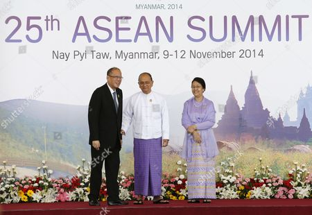 Myanmar President Thein Sein (2-l) Standing with His Wife Daw Khin Khin Win (2-r) Greets Philippines President Benigno Aquino Iii (l) at the Official Leaders Greeting During the Opening Ceremony For the 25th Association of South East Asian Nations (asean) Summit at Myanmar International Convention Center in Naypyitaw Myanmar 12 November 2014 South-east Asian Leaders Gathered in Myanmar's Capital Naypyidaw on 12 November For the Bi-annual Asean Summit with the Focus Expected to Be on Economic Ties and Regional Territorial Disputes the Final Provisions of the Asean Economic Community - Due to Be Completed in December 2015 - Will Be High on the Agenda of the Two-day Conference the 10 Member Countries Will Also Be Launching a Green Economy Initiative to Combat Global Warming Asean Comprises Brunei Indonesia Malaysia the Philippines Singapore Thailand Vietnam Cambodia Laos and Myanmar the Asean Meetings Will Also Include Leaders From South Korea Australia New Zealand and Russia Myanmar Naypyitaw