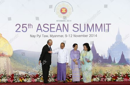 Myanmar President Thein Sein (2-l) Standing with His Wife Khin Khin Win (2-r) Signals the Way Into the Opening Ceremony to Malaysia Prime Minister Najib Razak (l) and His Wife Rosmah Mansor (r) at the Official Leaders Greeting For the 25th Association of South East Asian Nations (asean) Summit at Myanmar International Convention Center in Naypyitaw Myanmar 12 November 2014 South-east Asian Leaders Gathered in Myanmar's Capital Naypyidaw on 12 November For the Bi-annual Asean Summit with the Focus Expected to Be on Economic Ties and Regional Territorial Disputes the Final Provisions of the Asean Economic Community - Due to Be Completed in December 2015 - Will Be High on the Agenda of the Two-day Conference the 10 Member Countries Will Also Be Launching a Green Economy Initiative to Combat Global Warming Asean Comprises Brunei Indonesia Malaysia the Philippines Singapore Thailand Vietnam Cambodia Laos and Myanmar the Asean Meetings Will Also Include Leaders From South Korea Australia New Zealand and Russia Myanmar Naypyitaw