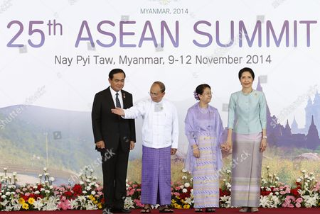 Myanmar President Thein Sein (2-l) Standing with His Wife Khin Khin Win (2-r) Signals the Way Into the Opening Ceremony to Thailand Prime Minister Prayut Chan-o-cha (l) and His Wife Naraporn Chan-o-cha For the Start of the 25th Association of South East Asian Nations (asean) Summit at Myanmar International Convention Center in Naypyitaw Myanmar 12 November 2014 South-east Asian Leaders Gathered in Myanmar's Capital Naypyidaw on 12 November For the Bi-annual Asean Summit with the Focus Expected to Be on Economic Ties and Regional Territorial Disputes the Final Provisions of the Asean Economic Community - Due to Be Completed in December 2015 - Will Be High on the Agenda of the Two-day Conference the 10 Member Countries Will Also Be Launching a Green Economy Initiative to Combat Global Warming Asean Comprises Brunei Indonesia Malaysia the Philippines Singapore Thailand Vietnam Cambodia Laos and Myanmar the Asean Meetings Will Also Include Leaders From South Korea Australia New Zealand and Russia Myanmar Naypyitaw