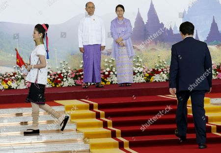 Myanmar President Thein Sein and His Wife Khin Khin Win Receive Vietnam Prime Minister Nguyen Tan Dung at the Official Welcome Led by a Myanmar Flag Bearer Wearing the Ethnic Tribal Peoples Dress of the Long-neck Padaung (kayan) People of Brass Neck Ring Collar and Brass Coils on Her Legs (l) at the Start of the 25th Association of South East Asian Nations (asean) Summit at the Myanmar International Convention Center in Naypyitaw Myanmar 12 November 2014 Myanmar Hosts the Summit From 09-13 November Between Asean Member Countries and Its Dialogue Partners Also a Meeting of the East Asia Summit (eas) Forum Aimed to Strengthen Political and Cultural Ties and Discuss Solution and Advancements of a Robust Global Economy Myanmar Naypyitaw