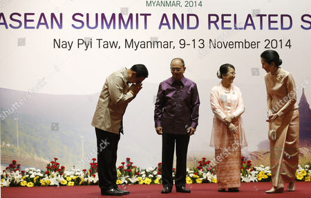 (l-r) Thailand Prime Minister Prayut Chan-o-cha Makes a Wai Bow to Myanmar President Thein Sein with His Wife Khin Khin Win (2-r) Speaking with and Naraporn Chan-o-cha Before the Banquet Dinner at the 25th Association of South East Asian Nations (asean) Summit and Related Summits at the Myanmar International Convention Center in Naypyitaw Myanmar 12 November 2014 Myanmar Naypyitaw