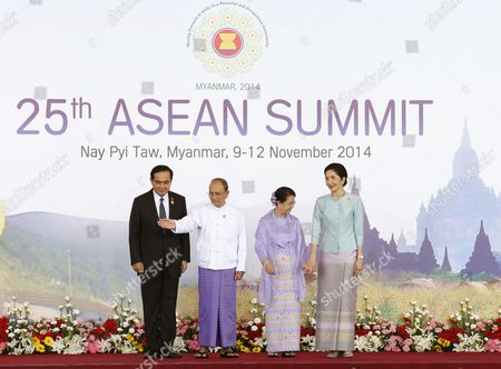 Myanmar President Thein Sein (2-l) Standing with His Wife Daw Khin Khin Win (2-r) Shows the Way Into the Opening Ceremony to Thailand's Prime Minister Prayut Chan-o-cha (l) and His Wife Naraporn Chan-o-cha (r) at the Official Leaders Greeting During the Opening Ceremony For the 25th Association of South East Asian Nations (asean) Summit at Myanmar International Convention Center in Naypyitaw Myanmar 12 November 2014 South-east Asian Leaders Gathered in Myanmar's Capital Naypyidaw on 12 November For the Bi-annual Asean Summit with the Focus Expected to Be on Economic Ties and Regional Territorial Disputes the Final Provisions of the Asean Economic Community - Due to Be Completed in December 2015 - Will Be High on the Agenda of the Two-day Conference the 10 Member Countries Will Also Be Launching a Green Economy Initiative to Combat Global Warming Asean Comprises Brunei Indonesia Malaysia the Philippines Singapore Thailand Vietnam Cambodia Laos and Myanmar the Asean Meetings Will Also Include Leaders From South Korea Australia New Zealand and Russia Myanmar Naypyitaw