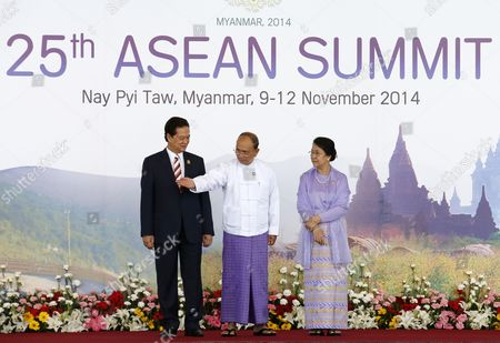 Myanmar President Thein Sein and His Wife Khin Khin Win (r) Receive Vietnam Prime Minister Nguyen Tan Dung (l) at the Official Welcome at the Start of the 25th Association of South East Asian Nations (asean) Summit at the Myanmar International Convention Center in Naypyitaw Myanmar 12 November 2014 Myanmar Hosts the Summit From 09-13 November Between Asean Member Countries and Its Dialogue Partners Also a Meeting of the East Asia Summit (eas) Forum Aimed to Strengthen Political and Cultural Ties and Discuss Solution and Advancements of a Robust Global Economy Myanmar Naypyitaw
