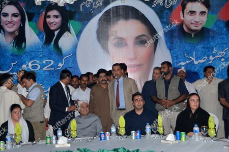 Former President and Co-chariman of Largest Opposition Party Pakistan People Part Asif Zardari (2-l) Sits with His Children From (l-r) Asifa Bhutto Zardari Bilawal Bhutto Zardari and Bakhtawar Zardari to Observe the Birth Anniversary of Former Prime Minister Benazir Bhutto in Gari Khuda Buksh Pakistan 21 June 2015 Asif Zardari Visited the Mausoleum of Benazir Bhutto to Observe Her 62nd Birth Anniversary Beanzir Bhutto was Assasinated 0n 27 December 2007 During an Election Campaign in Rawalpindi Pakistan Gari Khuda Buksh