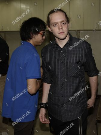 Australian National Arthur Murray Nash (l) and British National James Gates (r) Prepare to Come out of a Regional Trial Court Hearing in Quezon City East of Manila Philippines 14 August 2013 Court Records Showed That the Brothers a Third British National and an Australian National Faced Charges Including Alleged Illegal Drugs Use and Possession Following an Incident in January when Filipino Luis 'Chavit' Singson a Former Provincial Governor Called Police After Finding the Foreign Nationals in His Home in Quezon City and Suspecting That They Were Conducting 'Illicit Activities ' a Regional Trial Court Judge on 14 August Ordered in Open Court That the Cases Against the Four Suspects Be Provisionally Dismissed Following an Affidavit From Singson Expressing That He is No Longer Interested in Pursuing the Case Philippines Manila
