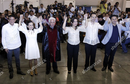 Chairman of the Commission on Elections (comelec) Sixto Brillantes (3-l) Raises Hands with Senators-elect Francis Escudero (l) Grace Poe (2-l) Loren Legarda (3-r) Alan Peter Cayetano (2-r) and Juan Edgardo Angara (r) During the Proclamation of the Senatorial Elections Winners at Philippine International Convention Center in Pasay City South of Manila Philippines 16 May 2013 Three Days After the Country's Mid-term Elections Comelec Proclaimed Six of the 12 Winners in the Senatorial Race Philippines Manila