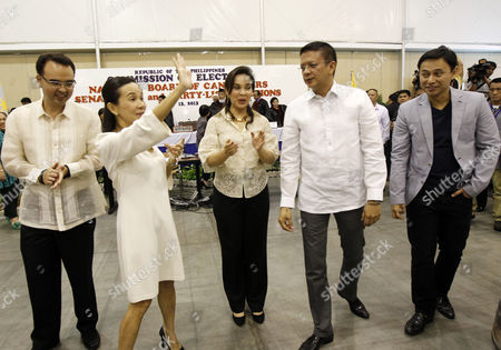 Stock Image of (l-r) Senators-elect Alan Peter Cayetano Grace Poe Loren Legarda Francis Escudero and Juan Edgardo Angara Celebrate During the Proclamation of the Senatorial Elections Winners at Philippine International Convention Center in Pasay City South of Manila Philippines 16 May 2013 Three Days After the Country's Mid-term Elections the Commission on Elections (comelec) Proclaimed Six of the 12 Winners in the Senatorial Race not in Photo is Senator -elect Nancy Binay Philippines Manila
