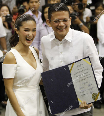 Senator-elect Francis Escudero (r) with Girl Friend Celebrity Heart Evangelista (l) Holds a Certificate of Proclamation at Philippine International Convention Center in Pasay City South of Manila Philippines 16 May 2013 Three Days After the Country's Mid-term Elections the Commission on Elections (comelec) Proclaimed Six of the 12 Winners in the Senatorial Race Philippines Manila