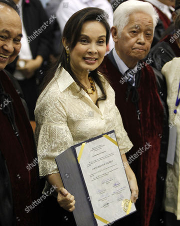 Stock Picture of Senator-elect Loren Legarda (c) Holds a Certificate of Proclamation at Philippine International Convention Center in Pasay City South of Manila Philippines 16 May 2013 Three Days After the Country's Mid-term Elections the Commission on Elections (comelec) Proclaimed Six of the 12 Winners in the Senatorial Race Philippines Manila