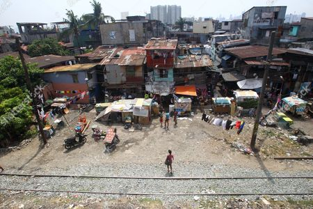 A View of Shanties Along Train Tracks in Manila Philippines 19 March 2015 State-owned Train System Philippine National Railway (pnr) Will Upgrade Its Railways and Locomotives Through Partnership with American Based Companies Miescorrail Desco and General Electric (ge) According to United States Embassy Trade Commissioner Jim Mccarthy the Rehabilitation of Pnr is the First Major Upgrade Since Its Acquisition and Signified the Renewal of Business Ties Between the Philippines and the Us Mccarthy Added Philippines Manila