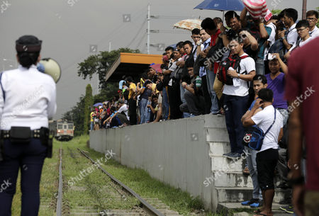 A Crowd of Filipino Passengers Are Seen at a Train Station in Taguig City South of Manila Philippines 20 November 2014 State-owned Train System Philippine National Railway (pnr) Will Upgrade Its Railways and Locomotives Through Partnership with American Based Companies Miescorrail Desco and General Electric (ge) According to United States Embassy Trade Commissioner Jim Mccarthy the Rehabilitation of Pnr is the First Major Upgrade Since Its Acquisition and Signified the Renewal of Business Ties Between the Philippines and the U S Mccarthy Added Epa/francis R Malasig Philippines Manila