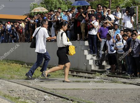 A Crowd of Filipino Passengers Are Seen at a Train Station in Taguig City South of Manila Philippines 20 November 2014 State-owned Train System Philippine National Railway (pnr) Will Upgrade Its Railways and Locomotives Through Partnership with American Based Companies Miescorrail Desco and General Electric (ge) According to United States Embassy Trade Commissioner Jim Mccarthy the Rehabilitation of Pnr is the First Major Upgrade Since Its Acquisition and Signified the Renewal of Business Ties Between the Philippines and the U S Mccarthy Added Philippines Manila