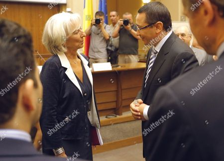 Stock Picture of Christine Lagarde (l) Managing Director of the International Monetary Fund (imf) Talks with Victor-viorel Ponta (r) the Prime Minister of Romania at the Romanian National Bank Headquarters in Bucharest Romania 16 July 2013 Lagarde is on a Two-days Official Visit to Romania Romania Bucharest