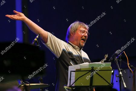 A Picture Made Available on 13 July 2013 Shows Brittish Saxophone Player and Jazz Composer John Surman Greeting the Audience While Performing with the Band Valhalla During the 17th Garana Jazz Festival 2013 in Garana Village (wolfsberg) Romania Late 12 July 2013 the Garana Jazz Festival Takes Place Annually in the Wild Surroundings of Semenic Mountain Foot Western Romania Romania Garana