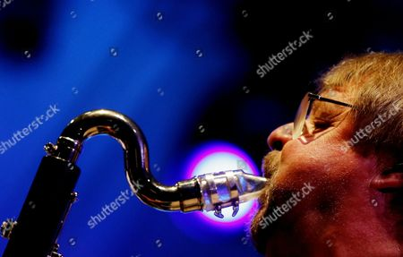 Stock Photo of A Picture Made Available on 13 July 2013 Shows Brittish Saxophone Player and Jazz Composer John Surman Performing with the Band Valhalla During the 17th Garana Jazz Festival 2013 in Garana Village (wolfsberg) Romania Late 12 July 2013 the Garana Jazz Festival Takes Place Annually in the Wild Surroundings of Semenic Mountain Foot Western Romania Romania Garana