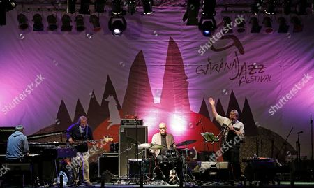 A Picture Made Available on 13 July 2013 Shows Brittish Saxophone Player and Jazz Composer John Surman (r) Greeting the Audience While Performing with the Band Valhalla During the 17th Garana Jazz Festival 2013 in Garana Village (wolfsberg) Romania Late 12 July 2013 the Garana Jazz Festival Takes Place Annually in the Wild Surroundings of Semenic Mountain Foot Western Romania Romania Garana