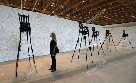 A Visitor Looks at the Artwork 'Blackthrone Series' by Kenyan Artist Wangechi Mutu During the 5th Moscow Biennale of Contemporary Art in Moscow Russia 19 September 2013 the Event Will Runs Until 20 October Russian Federation Moscow