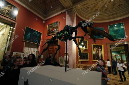 Visitors Look at the Flemish Artist Jan Fabre Artwork 'Fidelity and the Repetition of Death' During the Exhibition 'Knight of Despair/warrior of Beauty' Displayed in the Hermitage State Museum in St Petersburg Russia 21 October 2016 the Exhibition Runs From 21 October to 09 April 2017 Russian Federation St. Petersburg