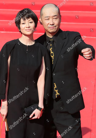Japanese Director Tatsushi Omori (r) and Actress Yoko Maki Arrive For the Closing Ceremony of the 35th International Film Festival in Moscow Russia 29 June 2013 Russian Federation Moscow