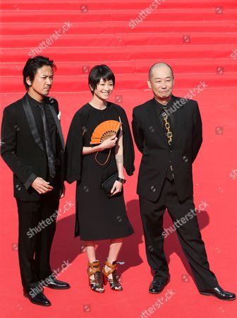 Stock Image of Japanese Director Tatsushi Omori (r) Actress Yoko Maki (c) and Actor Shima Onishi Arrive For the Closing Ceremony of the 35th International Film Festival in Moscow Russia 29 June 2013 Russian Federation Moscow