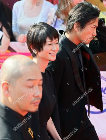 Stock Image of Japanese Director Tatsushi Omori (l) Actress Yoko Maki (c) and Actor Shima Onishi (r) Arrive For the Closing Ceremony of the 35th International Film Festival in Moscow Russia 29 June 2013 Russian Federation Moscow