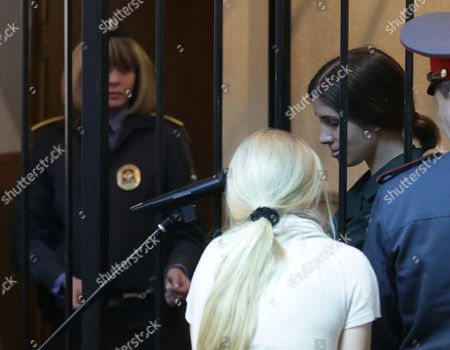 Russian Feminist Punk-rock Band Pussy Riot Member Nadezhda Tolokonnikova (r) Leaves a Court Session After Hearing the Verdict at the Zubova Polyana District Court in the Town of Zubova Polyana 440 Km Southeast From the Center of Moscow Russia 26 April 2013 the Court Rejected Tolokonnikova's Appeal For Parole in August 2012 Russian Feminist Punk-rock Band Pussy Riot Three Members Yekaterina Samutsevich Maria Alyokhina and Nadezhda Tolokonnikova Were Sentenced to Two-year Prison on Charges of Hooliganism Motivated by Religious Hatred After Singing a Song in the Christ the Savior Cathedral in Moscow in February 2012 Ahead of Presidential Elections in Russia Later the Court Replaced Yekaterina Samutsevich's Jail Term For a Suspended Sentence Russian Federation Zubova Polyana