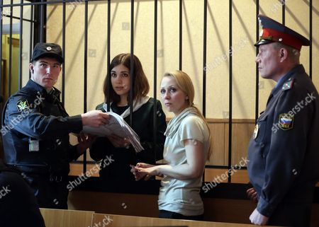 Russian Feminist Punk-rock Band Pussy Riot Member Nadezhda Tolokonnikova (2-l) Reads a Document During a Court Session at the Zubova Polyana District Court in Town of Zubova Polyana 440 Km Southeast From Moscow Republic of Mordovia Russia 26 April 2013 the Court Considers Nadezhda Tolokonnikova's Appeal For Parole in August 2012 Three Members of Russian Feminist Punk-rock Band Pussy Riot Yekaterina Samutsevich Maria Alyokhina and Nadezhda Tolokonnikova Were Sentenced to Two Years in Prison on Charges of Hooliganism Motivated by Religious Hatred After Singing a Song in the Christ the Savior Cathedral in Moscow in February 2012 Ahead of Presidential Elections in Russia Russian Federation Zubova Polyana